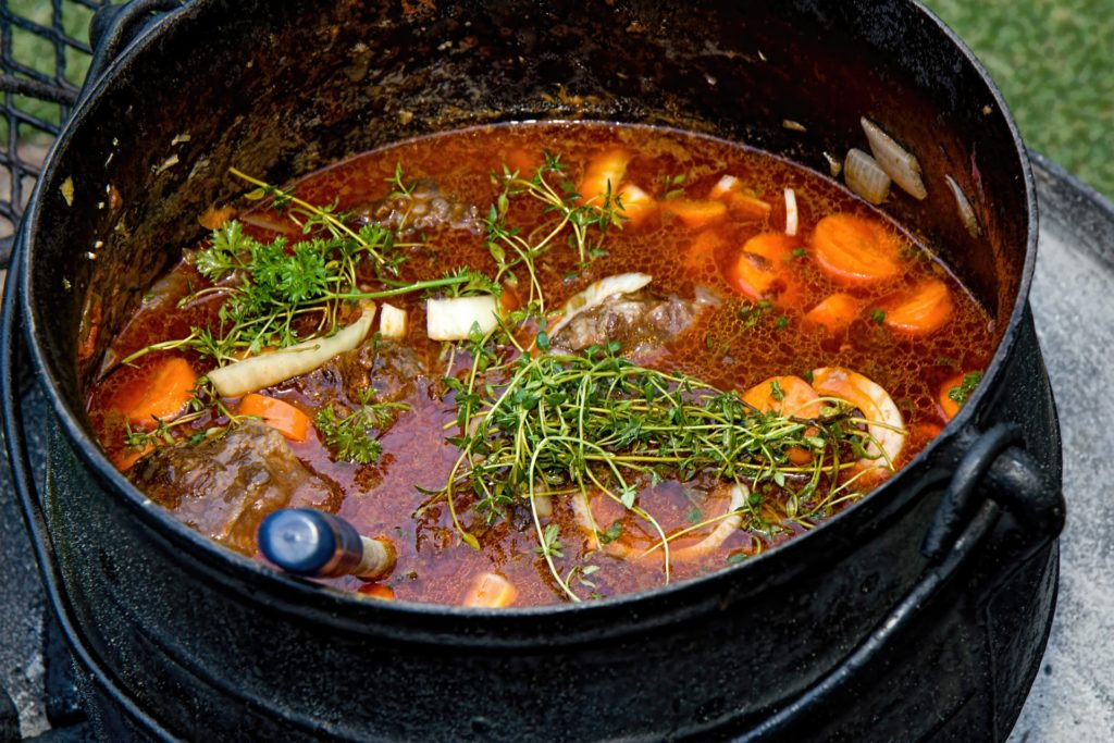 Purify Us, Oh God_vegetable stew in large black pot, herbs on top