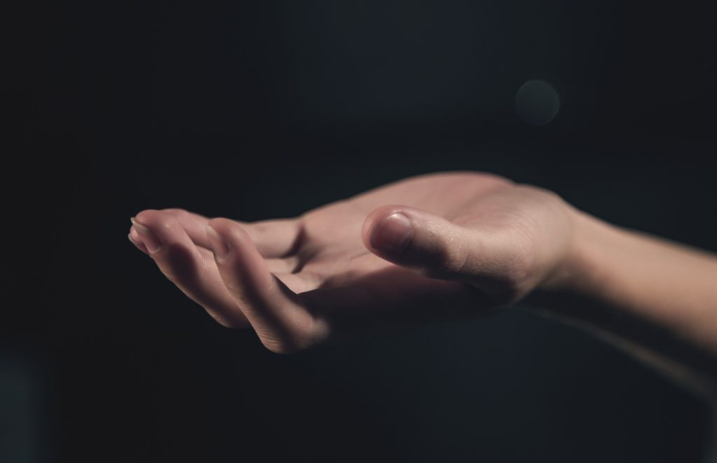 What If We Were Brave Enough to Open Our Hands_open hand with dark background