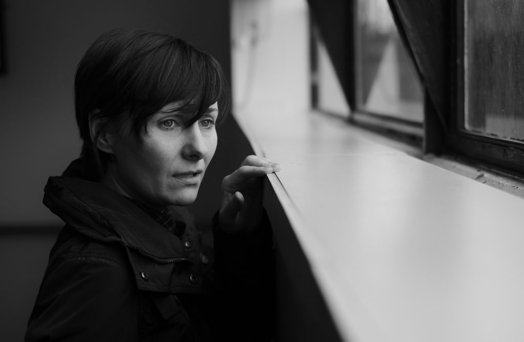 3 Steps for When You Know Something Bad Is Coming_black and white_anxious woman with short hair looking out a window