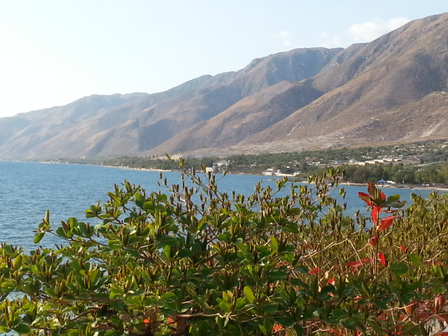When You Need Desperate Trust_tall, barren mountains in Haiti cascading down to the sea