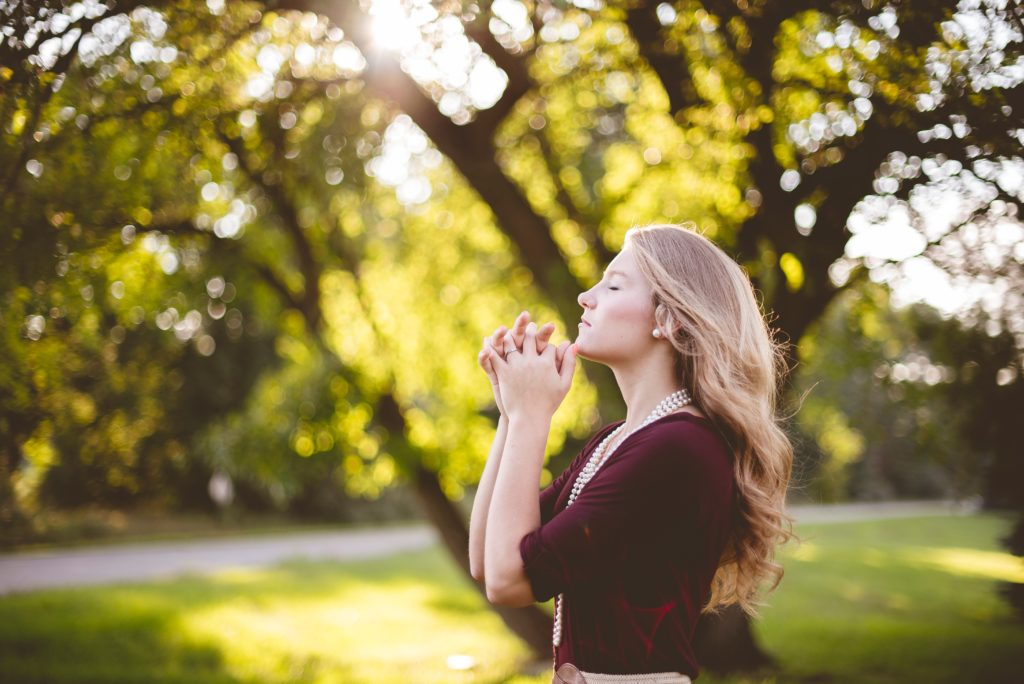 A Thanksgiving Prayer_woman standing by trees, praying eyes lifted to heaven