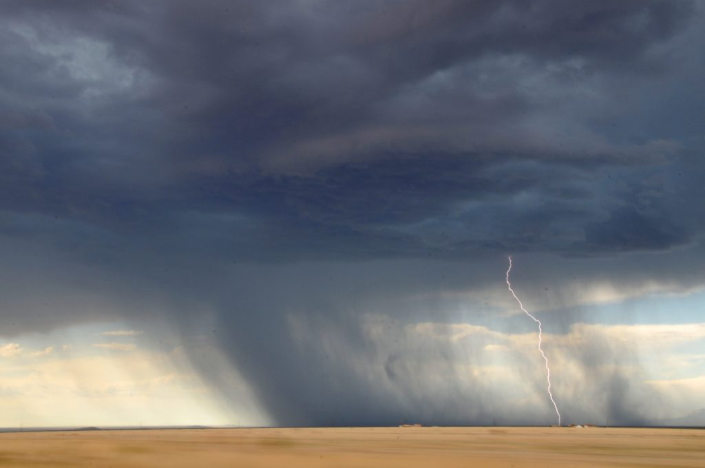 How to Know God Is Our Refuge_tornado forming, sweeping across open golden field